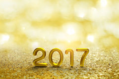 Gold 2017 Text on Gold bokeh. And light Background royalty free stock photo