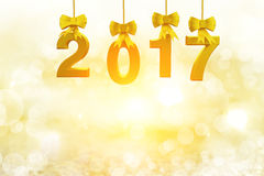 Gold 2017 Text and Snow icon Hanging on Soft light Royalty Free Stock Photos