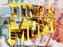 Gold text time is money on the background of Russian money Stock Photo