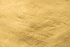 Gold texture. With bumps, scuffs and scratches Golden background Old gold paper. Golden texture Uneven background with the effect of distressed, scratches Royalty Free Stock Photography