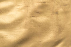 Gold texture. With bumps, scuffs and scratches Golden background Old gold paper. Golden texture Uneven background with the effect of distressed, scratches Stock Images