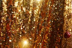Gold texture glitter background.  Lots of shining sparkles on a background. stock images