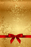 Gold texture with red bow Stock Photography