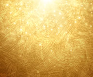 Gold Textured Background. Vector Illustration. Shining Christmas or New Year Backdrop. Golden Sunrays with Lights and Sparkles. Place for Your Text Message Stock Photos