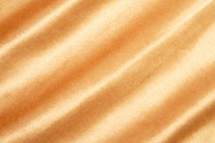 Gold textured fabric Stock Photography
