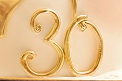 Gold 30 number text thirty sugar paste figurine. Gold dripping. Royalty Free Stock Photos