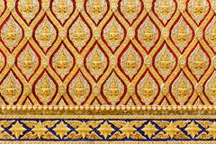 Gold thai art design. Thai style pattern design on a wall of  the temple, Thailand Stock Image