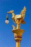 Gold thai swan molded figure with lamp in blue sky Stock Photos