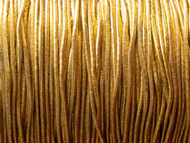 Gold thread. Pattern background close up detail Royalty Free Stock Images