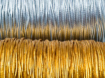Gold thread 2 silver thread. Gold thread 2 , silver thread close up in detail Stock Images