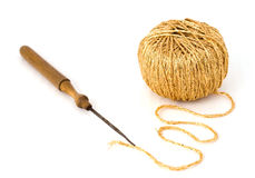 A gold thread and an old needle Royalty Free Stock Image