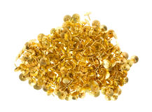 Gold thumbtacks on a white background Royalty Free Stock Photo
