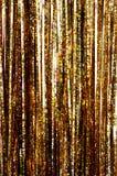 Gold tinsel. Closeup of gold Christmas tinsel royalty free stock photos