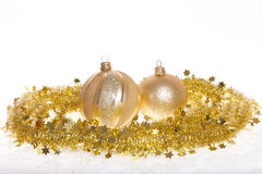 Gold tinsel and baubles Royalty Free Stock Photo