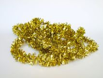 Gold tinsel rope garland. Christmas tree ornament, gold tinsel rope garland royalty free stock images