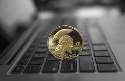 Gold Titan crypto coin on a laptop keyboard. Exchange, bussiness, commercial. Profit from mining crypt currencies. Miner. With ethereum coin stock photos