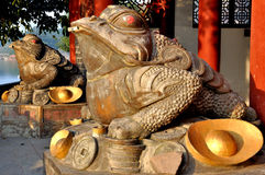 Gold Toad. Which is a symbol of prosperity in front of the God of Wealth Tower in Old Town of Zhouzi Stock Photography