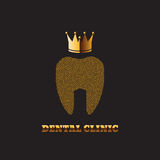 Gold Tooth with a Crown dark Background Stomatology Clinic Icon Stock Photos