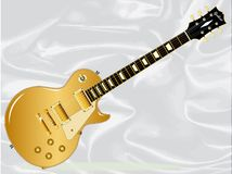 Gold Top Blues Guitar. The definitive rock and roll guitar in gold top isolated over a white silk background Stock Photography