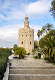 Gold Tower, a dodecagonal military watchtower in Seville (Spain) Stock Photos
