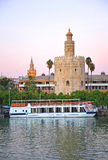 The Gold Tower, the Giralda tower and Guadalquivir river in Seville, Spain. The Torre del Oro, Golden Tower, almohad tower of defense in the old port of Seville royalty free stock photography