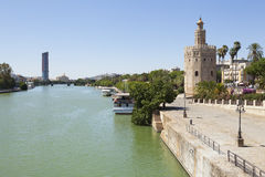 The Gold Tower and Guadalquivir river. The Golden Tower (Torre del Oro) in Seville, Andalusia, Spain. Copy space royalty free stock image