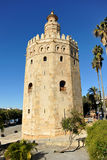 The Gold Tower, Seville, Spain. The Torre del Oro, Golden Tower, arabic tower of defense in the old port of Seville, Andalusia, Spain Stock Photography