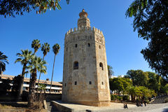 The Gold Tower, Seville, Spain. The Torre del Oro, Golden Tower, arabic tower of defense in the old port of Seville, Andalusia, Spain Stock Image