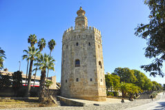 The Gold Tower, Seville, Spain. The Torre del Oro, Golden Tower, arabic tower of defense in the old port of Seville, Andalusia, Spain Royalty Free Stock Image