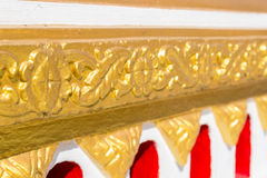 Gold tracery decoration on buddhist temple wall Royalty Free Stock Photo