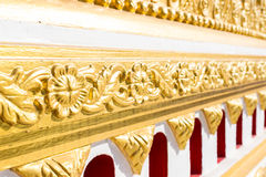 Gold tracery decoration on buddhist temple wall Stock Photo