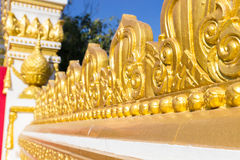 Gold tracery decoration on buddhist temple wall Royalty Free Stock Image