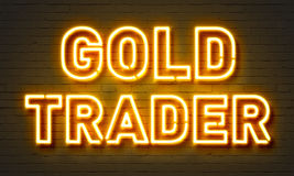 Gold trader neon sign on brick wall background. Stock Photos