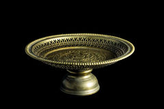 Gold tray with pedestal isolated on black background. Horizontal Royalty Free Stock Images