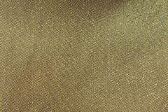 Gold tread on fabric, golden luxury background Stock Photos