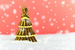 Gold tree ornament with snowy background Stock Photography