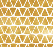 Gold triangle background. Metal painted background with triangular shapes. Royalty Free Stock Photography