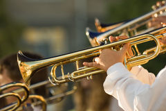 Gold trombones. Young musicians are playing on trombones Stock Images