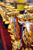 Gold trophies. Many gold trophies in a row stock photos