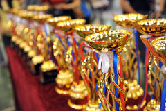 Gold trophies. Many gold trophies in a row stock photography