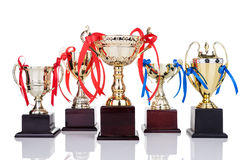 Gold trophies with decorative ribbons on white background Royalty Free Stock Image