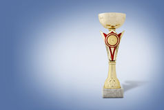 Gold trophy on a blue background Royalty Free Stock Images