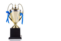 Gold trophy with blue decorative ribbons on white background Royalty Free Stock Images