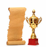 Gold trophy cup. With blank old paper scroll isolated on white stock photo