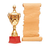 Gold trophy cup. With blank old paper scroll isolated on white stock photos