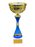 Gold trophy cup on pedestal with blank space. Isolated on white background stock photo