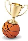 Gold trophy cup on top of the basketball ball Royalty Free Stock Photos