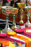 Gold trophy and ribbons Royalty Free Stock Image
