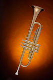 Gold Trumpet Isolated on Spotlight Royalty Free Stock Photos