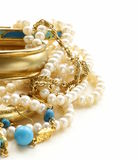 Gold, turquoise jewelry and pearl. On a white background Stock Image